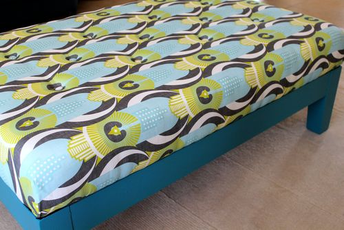 Emma's completed project, an ottoman recovered with Art Deco Rio De Janeiro fabric by Zesti